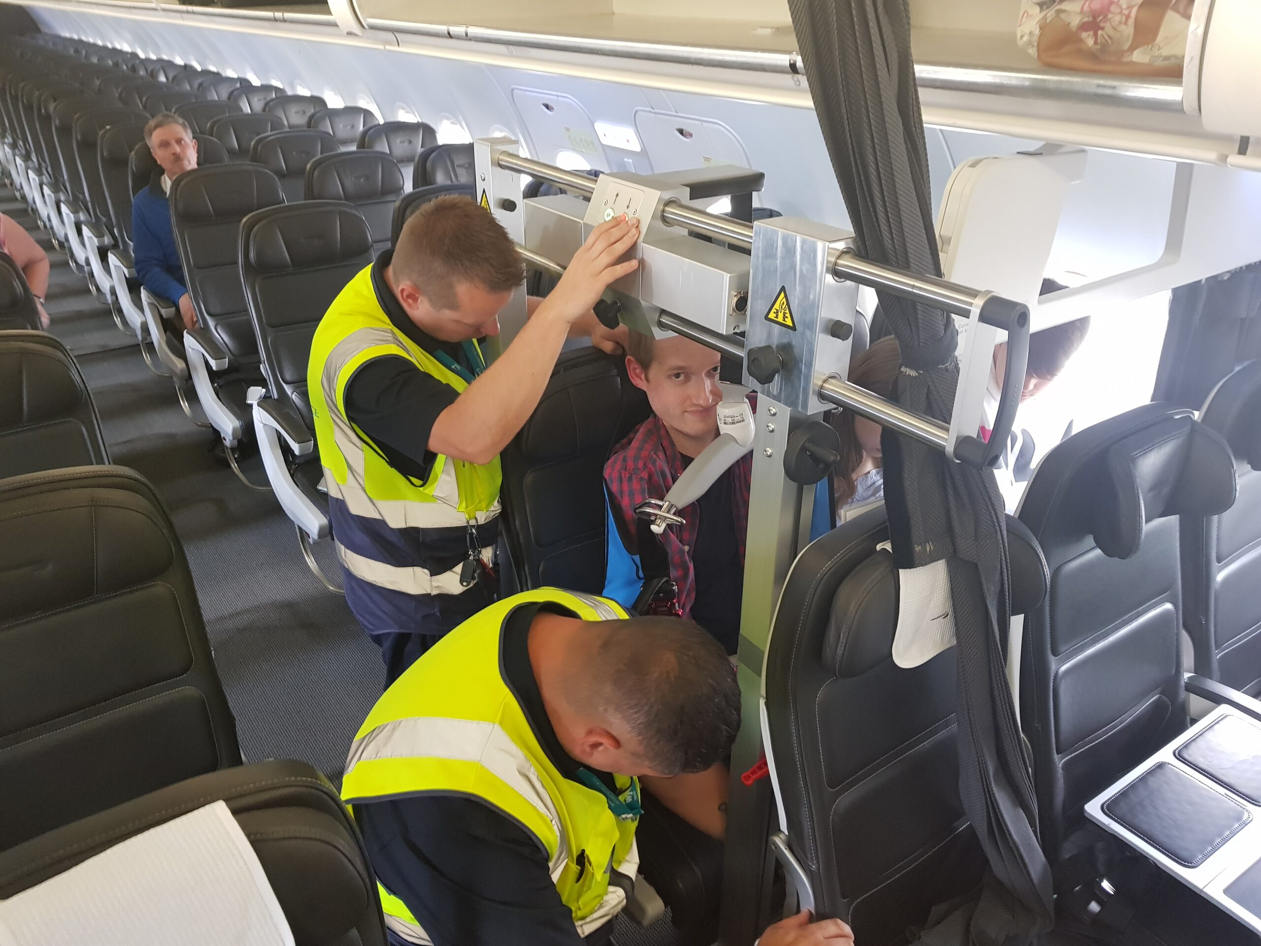 Being transferred into an aircraft seat